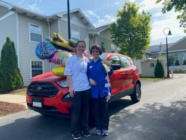Maricris Cooper, right, is joined by her daughter Colleen Cooper in front of the new Ford Ecosport Maricris won as part of the IntegraCare Continued Attendance Rewards (CAR) Program on Wednesday, May 19, 2021. Photo courtesy of IntegraCare.