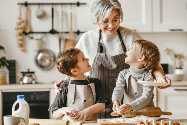 Senior woman baking in kitchen with grandkids
